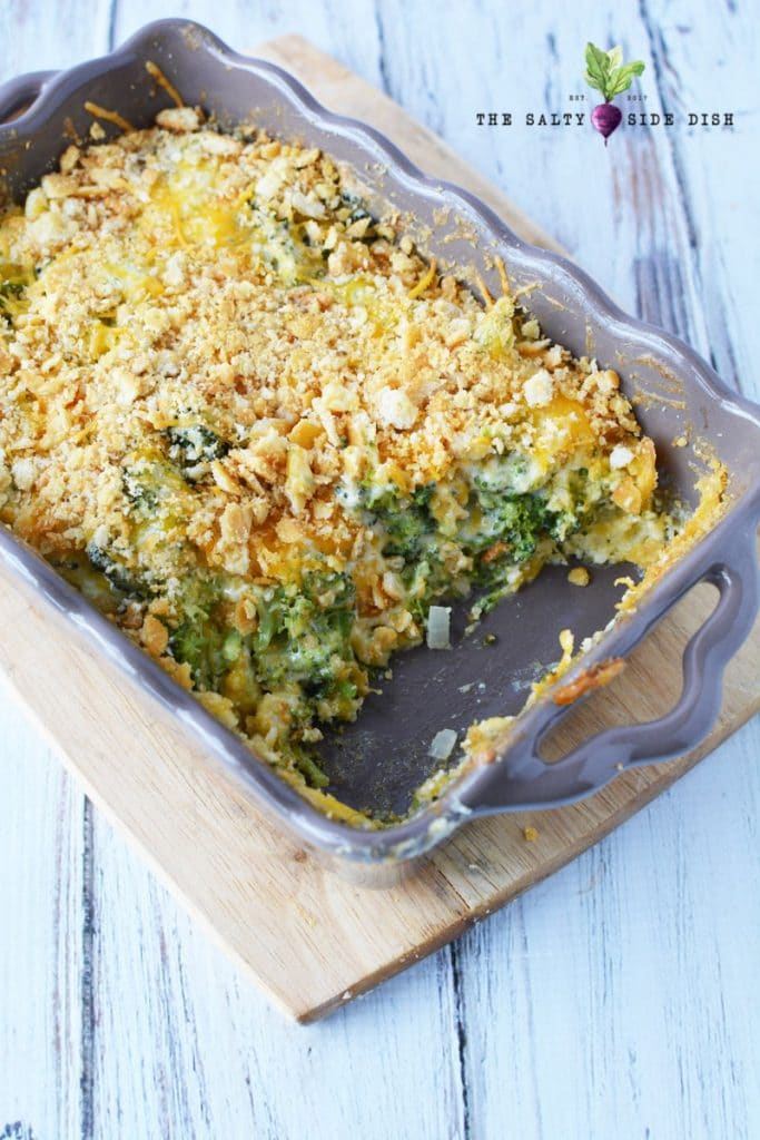 cooked broccoli casserole in pan that is ready to serve to a crowd