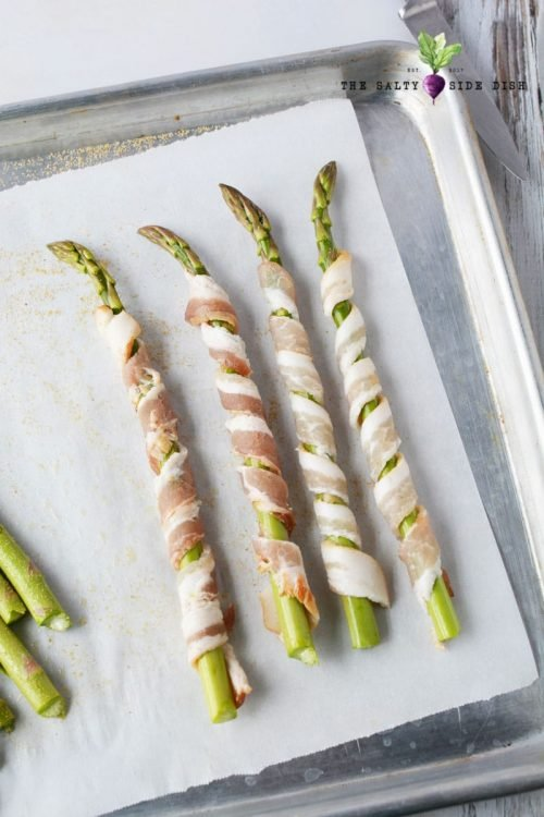 asparagus wrapped in uncooked bacon