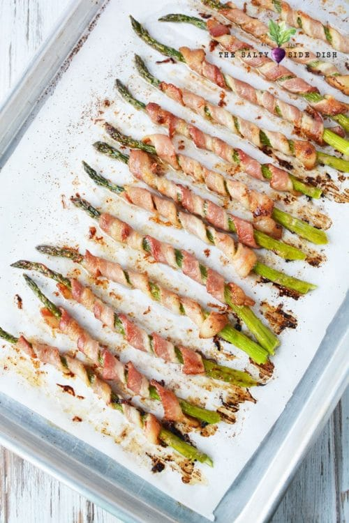bacon wrapped asparagus on a roasting pan