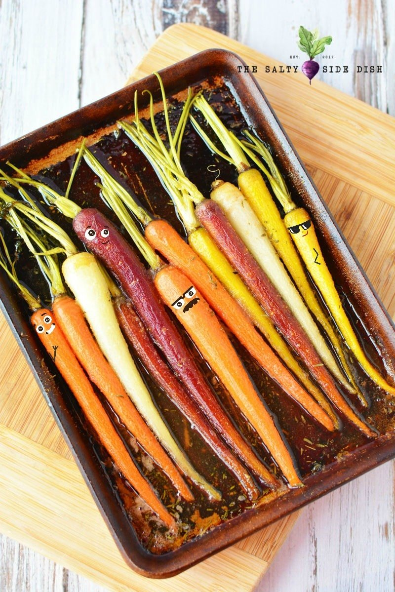 honey glazed carrots laying in a roasting pan