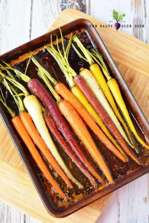 colorful carrots laying on a sheet pan
