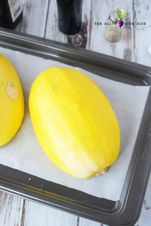 squash halves on baking pan