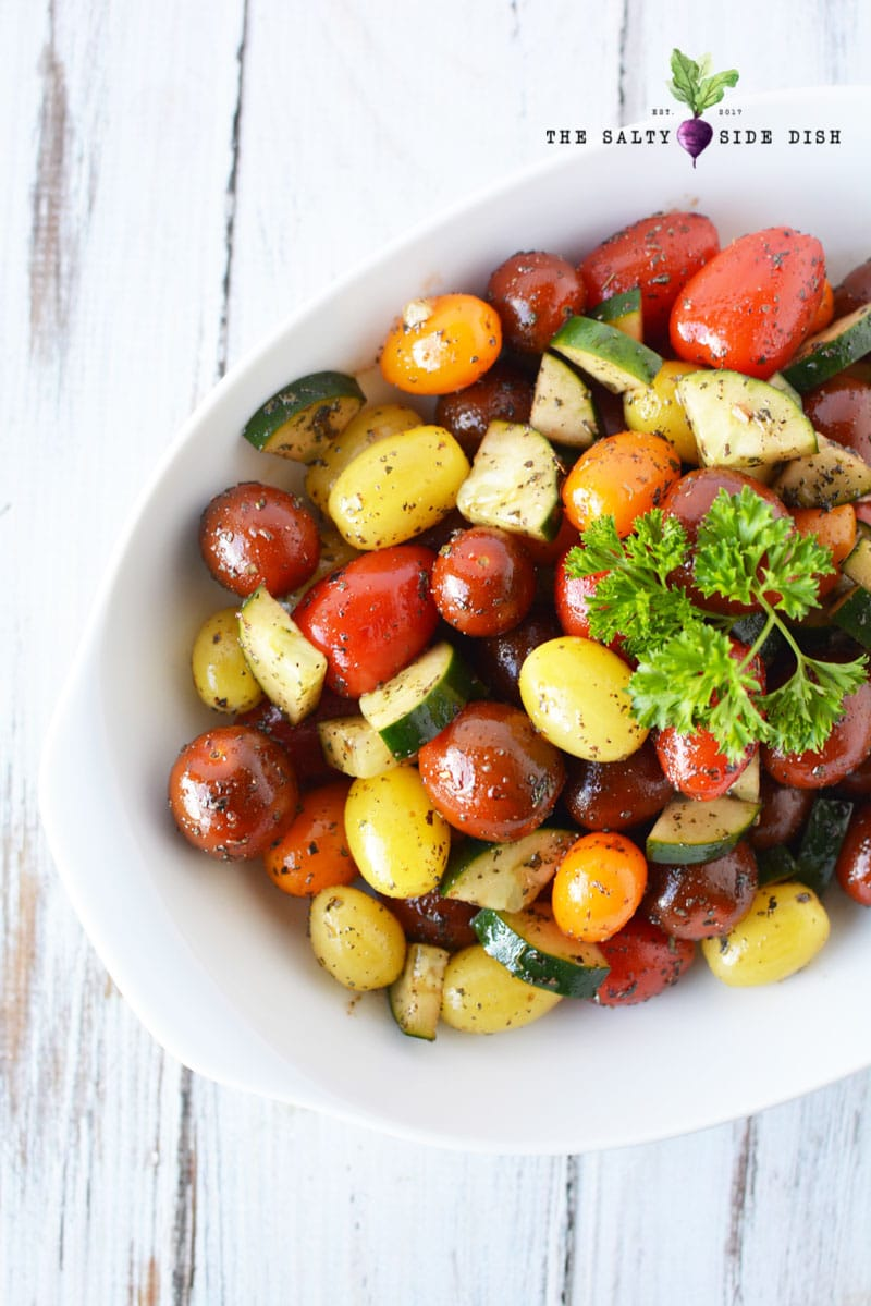 tomato side dish recipe in a bowl with fresh parsley