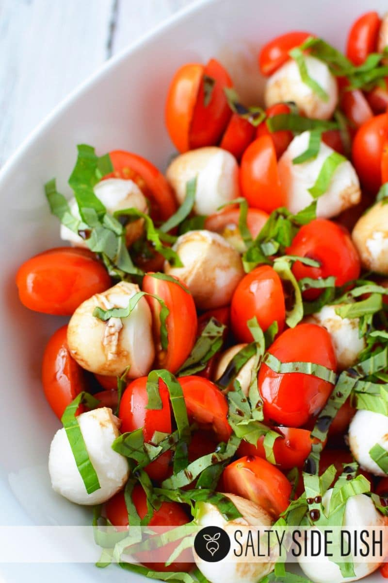 combine dressing, basil, tomatoes and mozzarella for the perfectly easy and simple Caprese salad