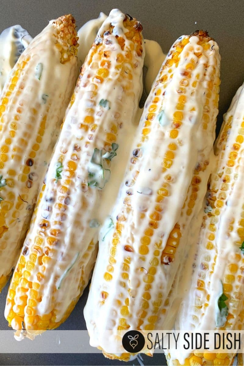 Spread mayo, sour cream and cilantro mixture onto the already grilled corn on the cob