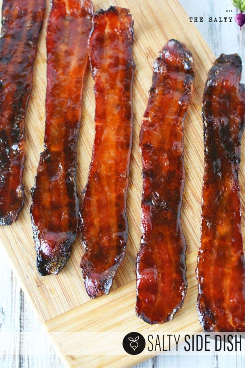 Candied bacon all laid out on a cutting board