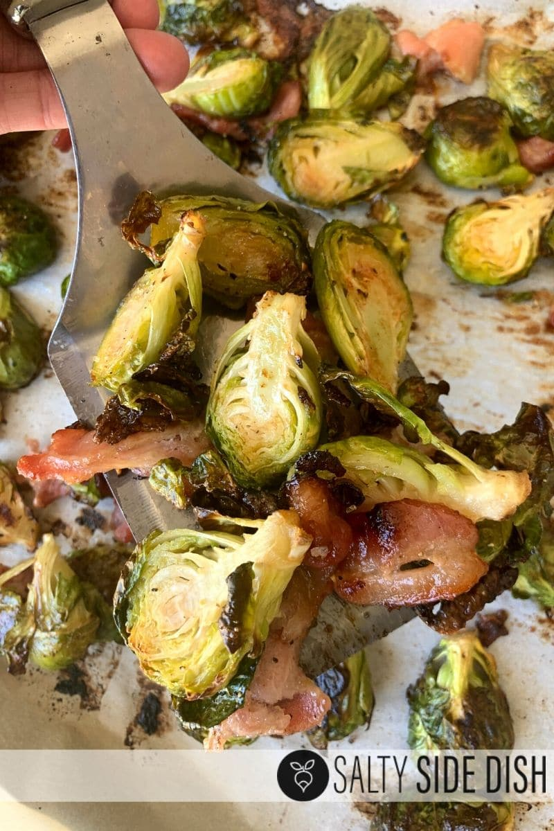 halved brussels sprouts with bacon on a spatula, already cooked
