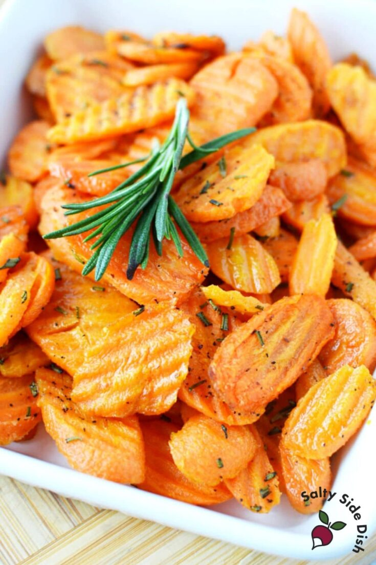 oven roasted carrots with rosemary in a white bowl