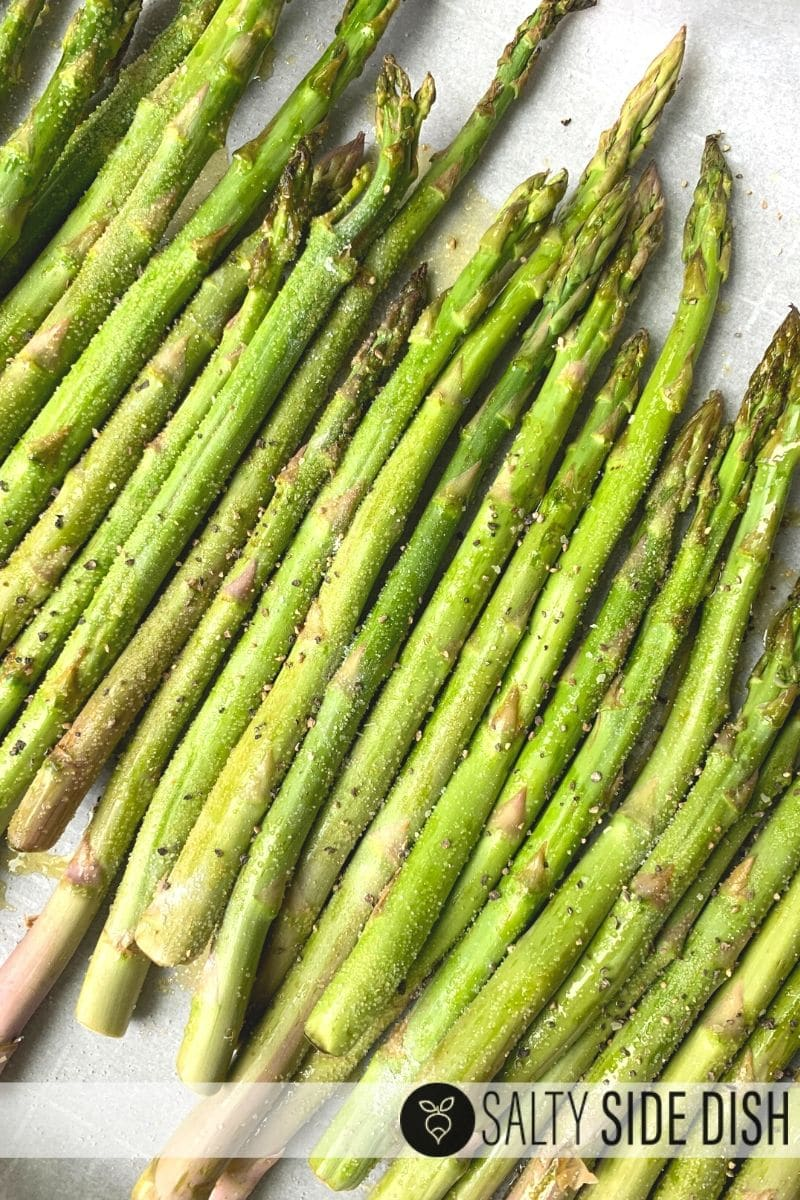 smother with garlic salt and pepper before placing asparagus in the oven