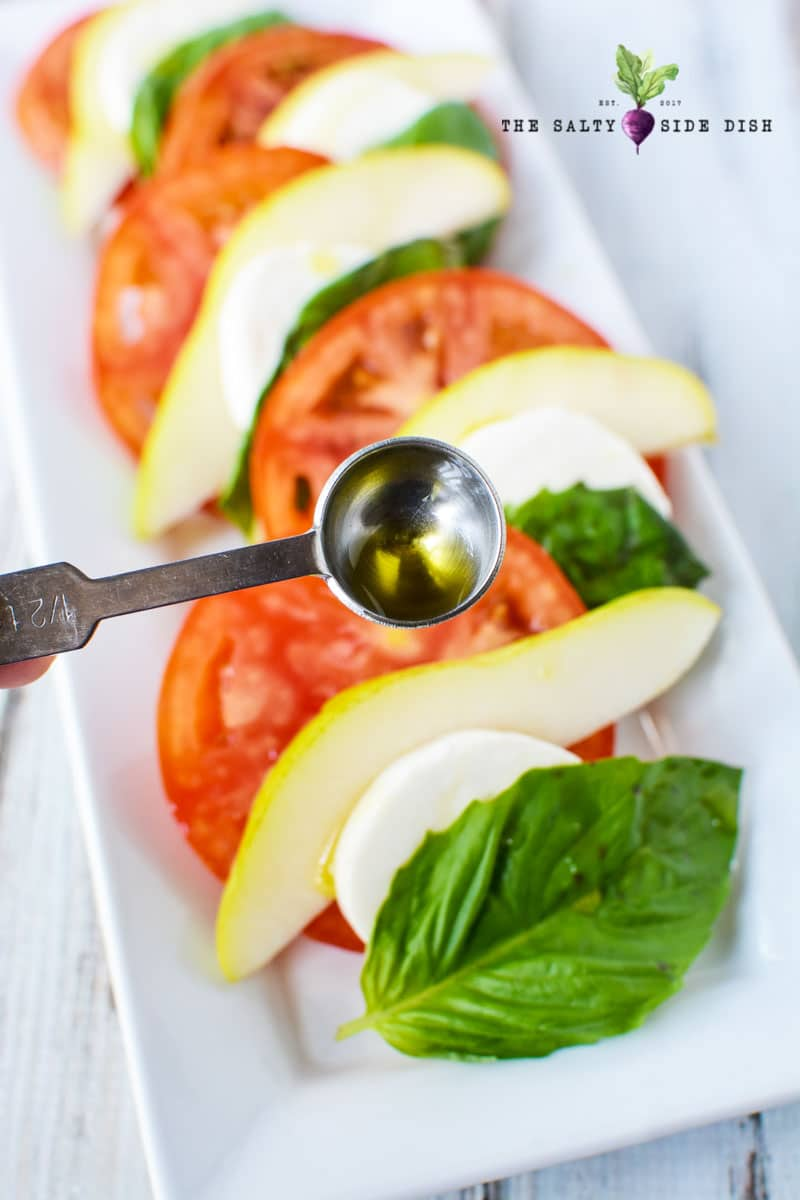 measuring olive for your caprese salad