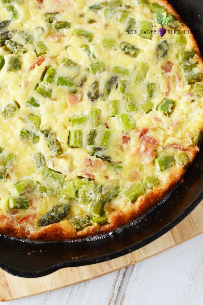 Crustless Parmesan Quiche with bacon and asparagus Baked in a cast iron pan