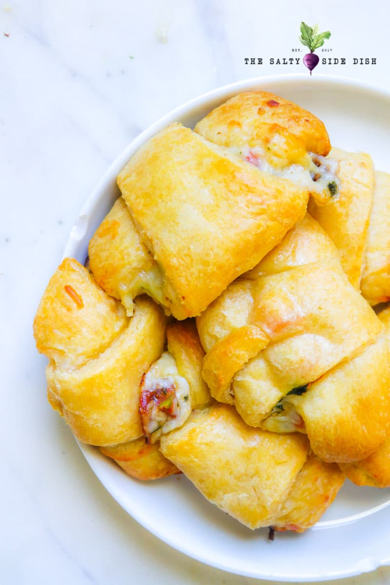 bowl of flaky crusty croissants that will go quickly