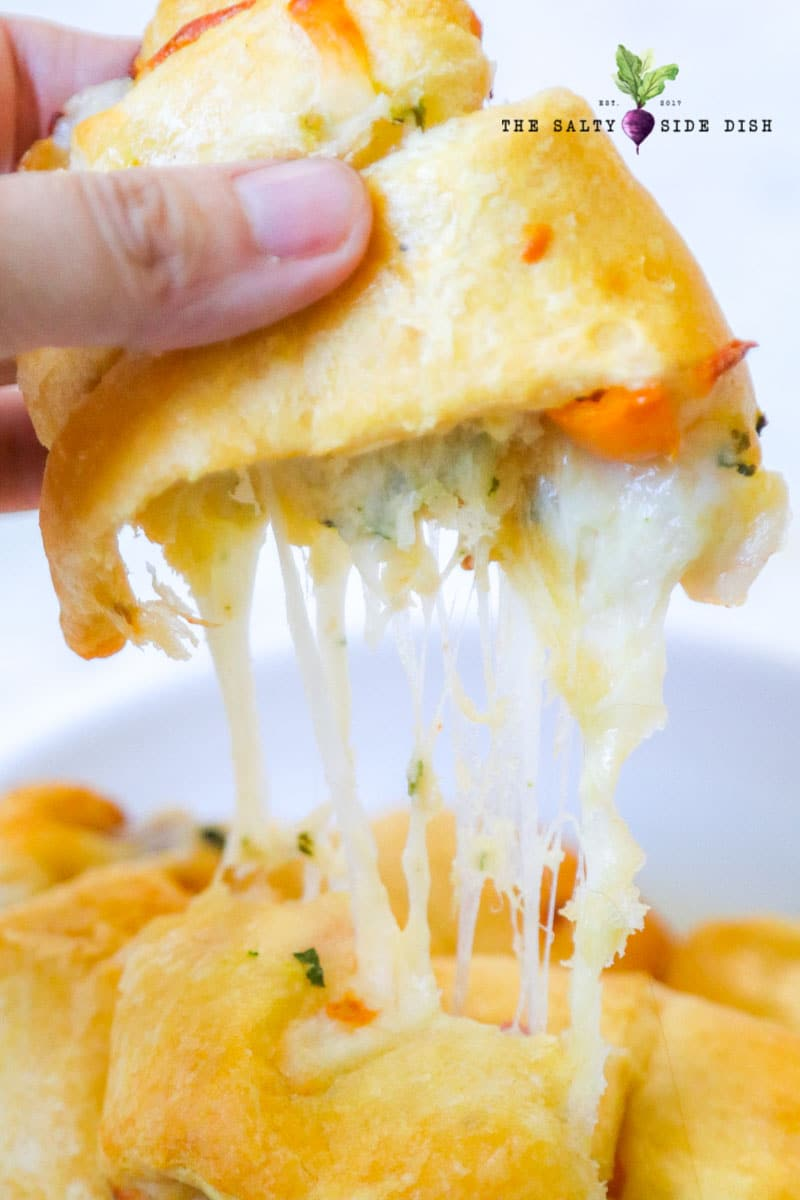 Cheesy croissant with melted cheese and tomatoes