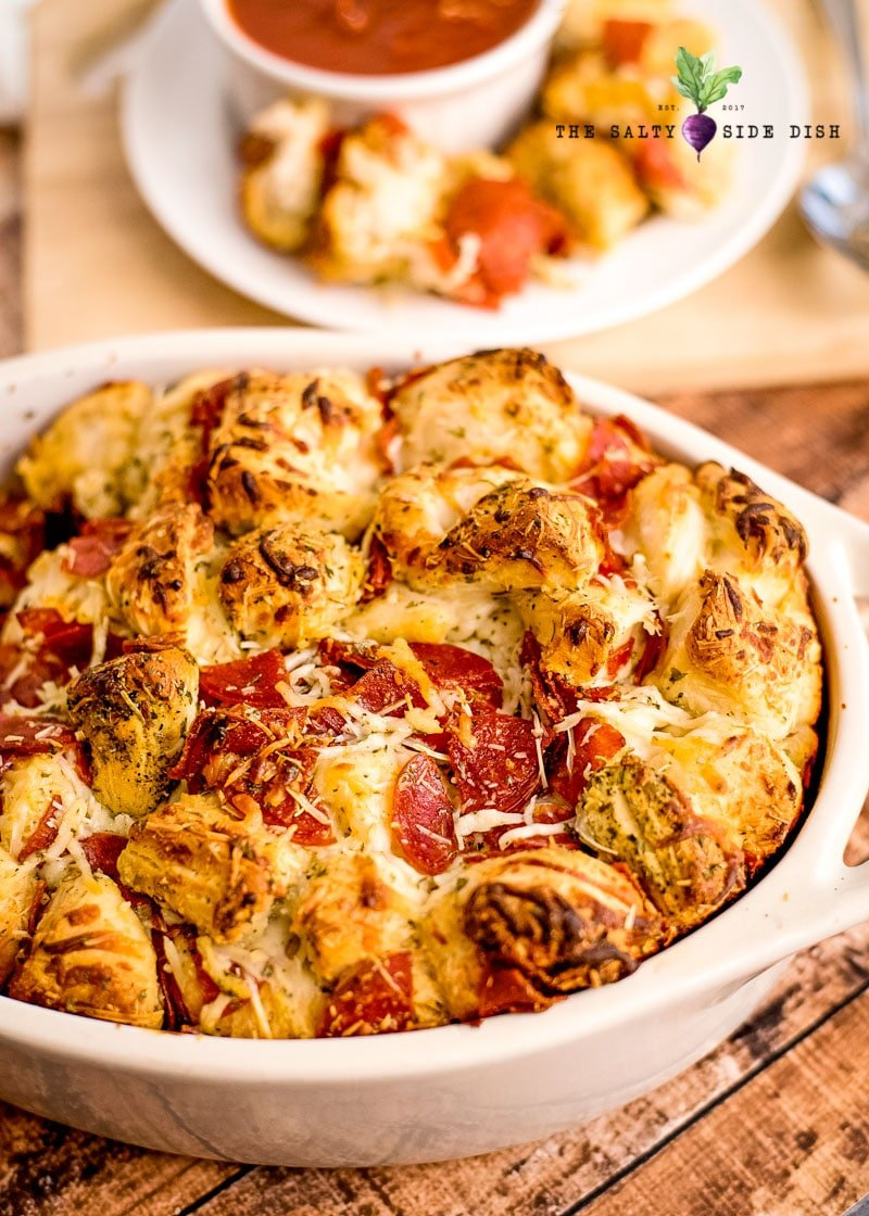 pull apart pizza bread in a casserole dish ready to serve