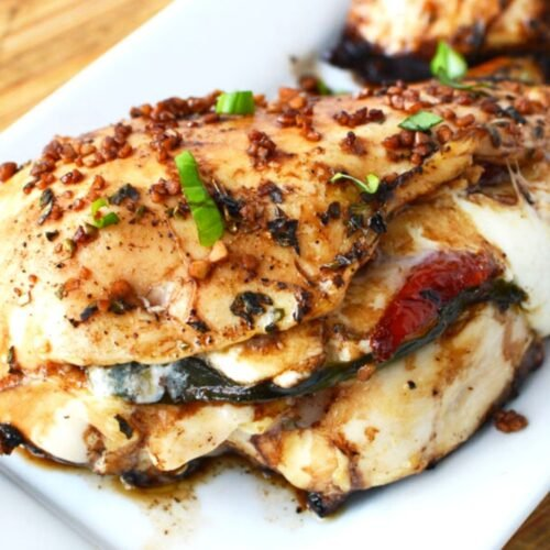 white plate with Caprese stuffed chicken.
