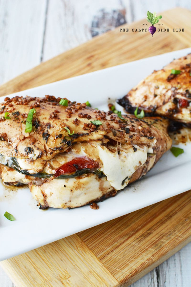 caprese stuffed chicken with melted cheese ready to serve for dinner