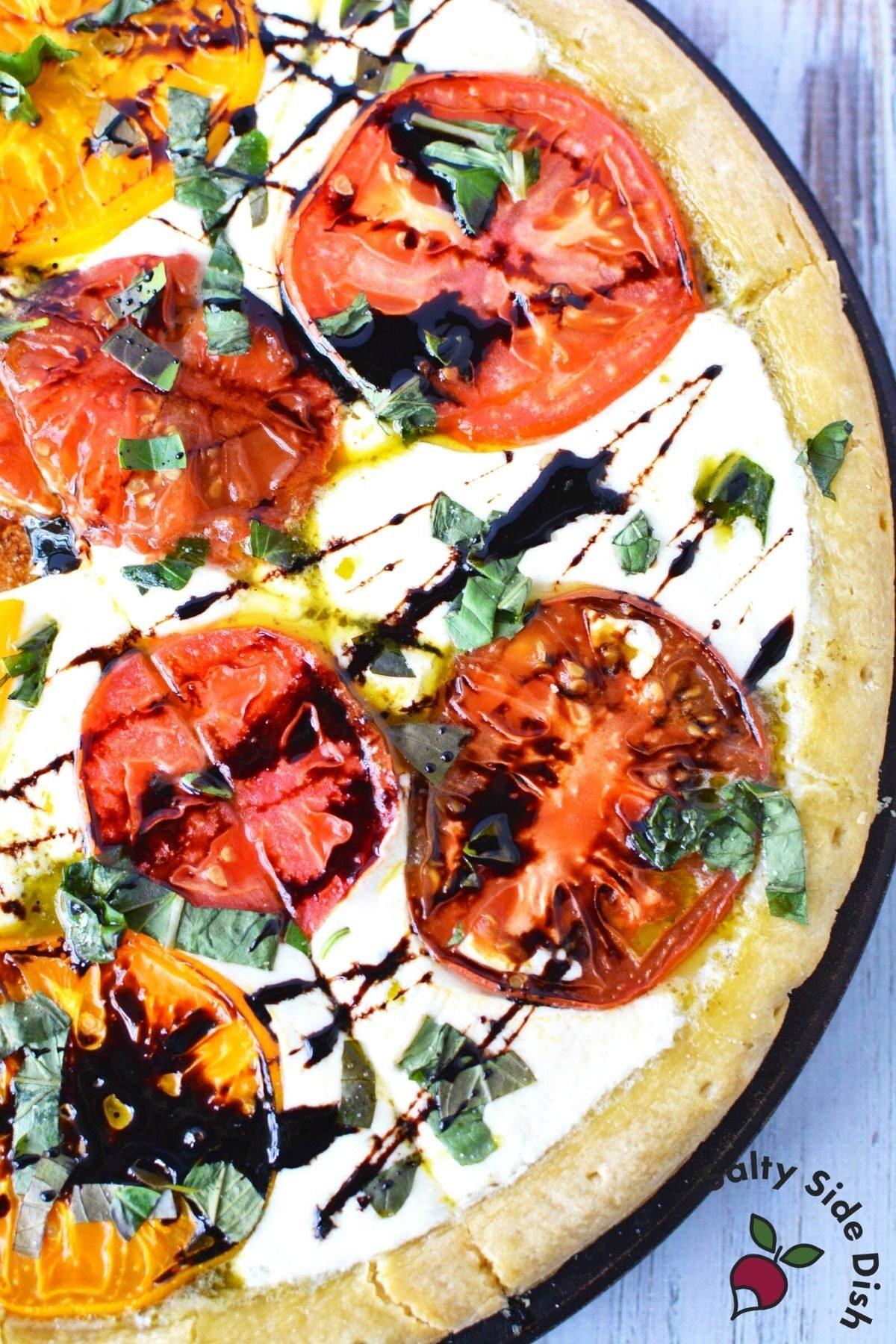 Caprese Pizza with balsamic glaze and garlic crust.