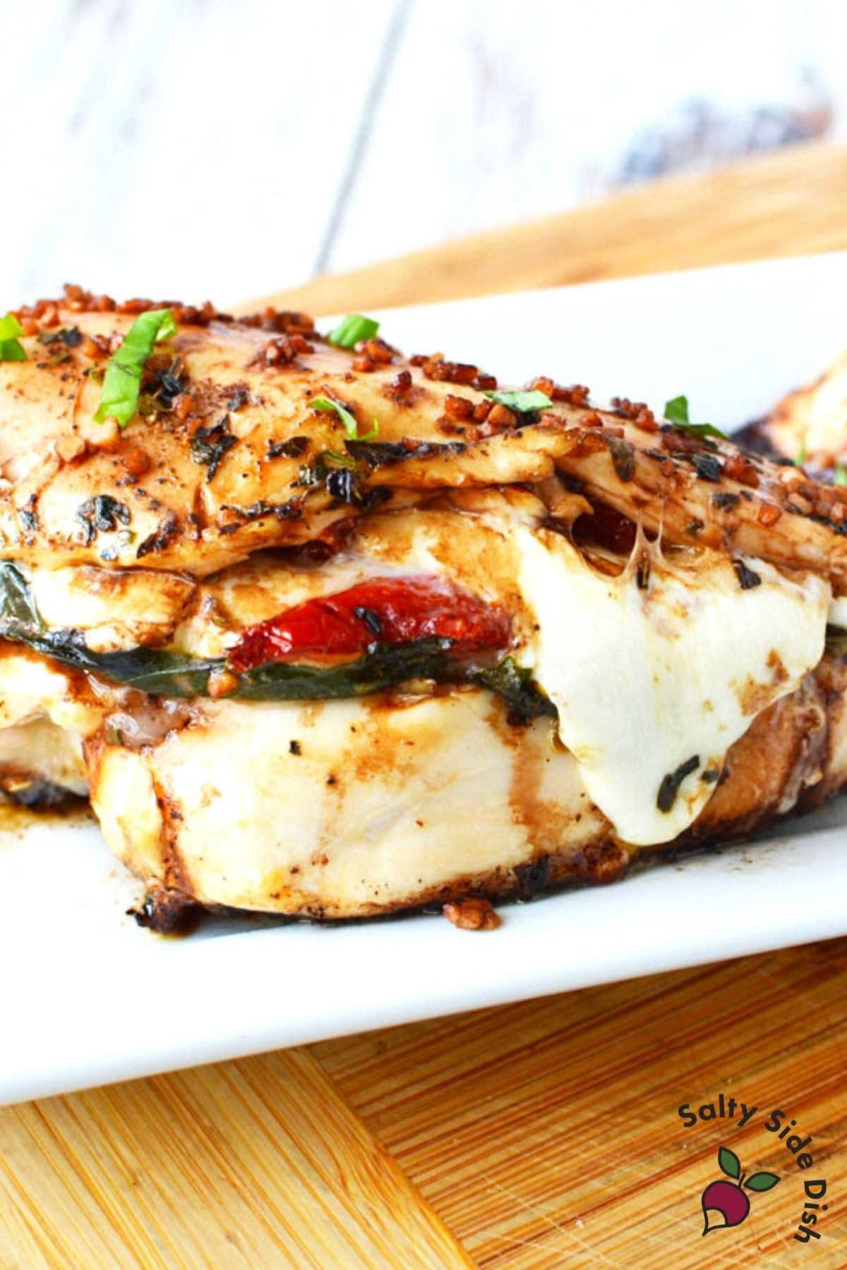 chicken breast with cheese and tomatoes falling out.