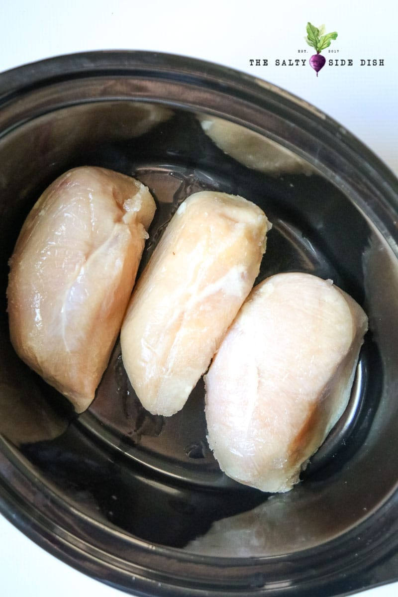 boneless skinless chicken breasts waiting in slow cooker