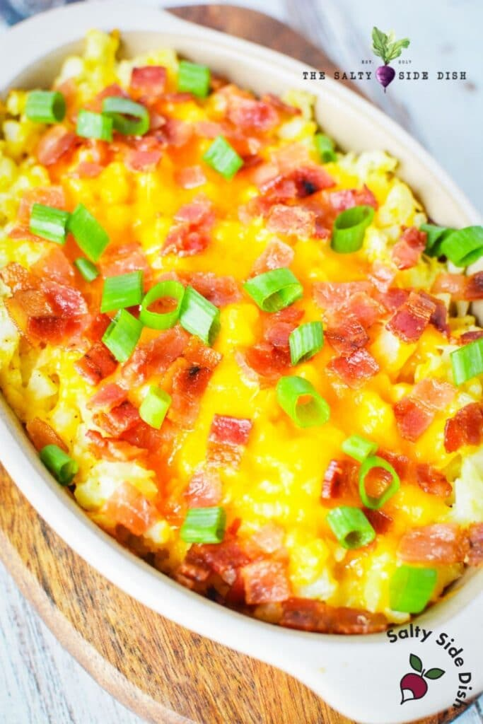 mashed cauliflower with cheese and bacon in a dish