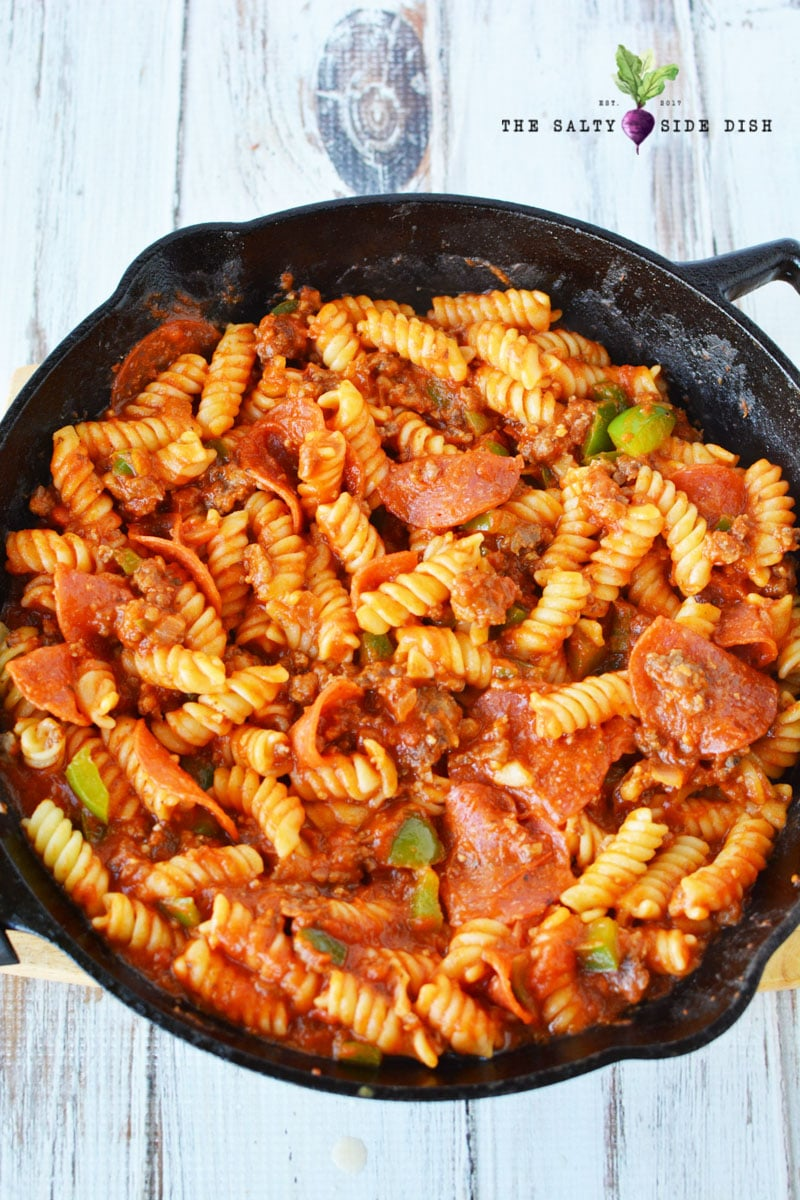 pasta and pepperoni mixed in sauce for a pizza side dish with delicious sausage and pepperonis