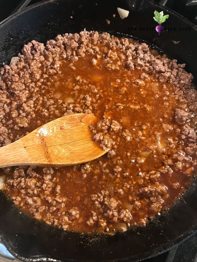 add your red enchilada sauce into the pan