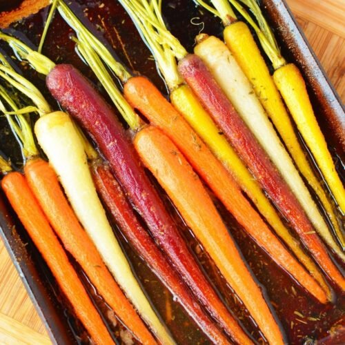colorful carrots on a baking sheet.