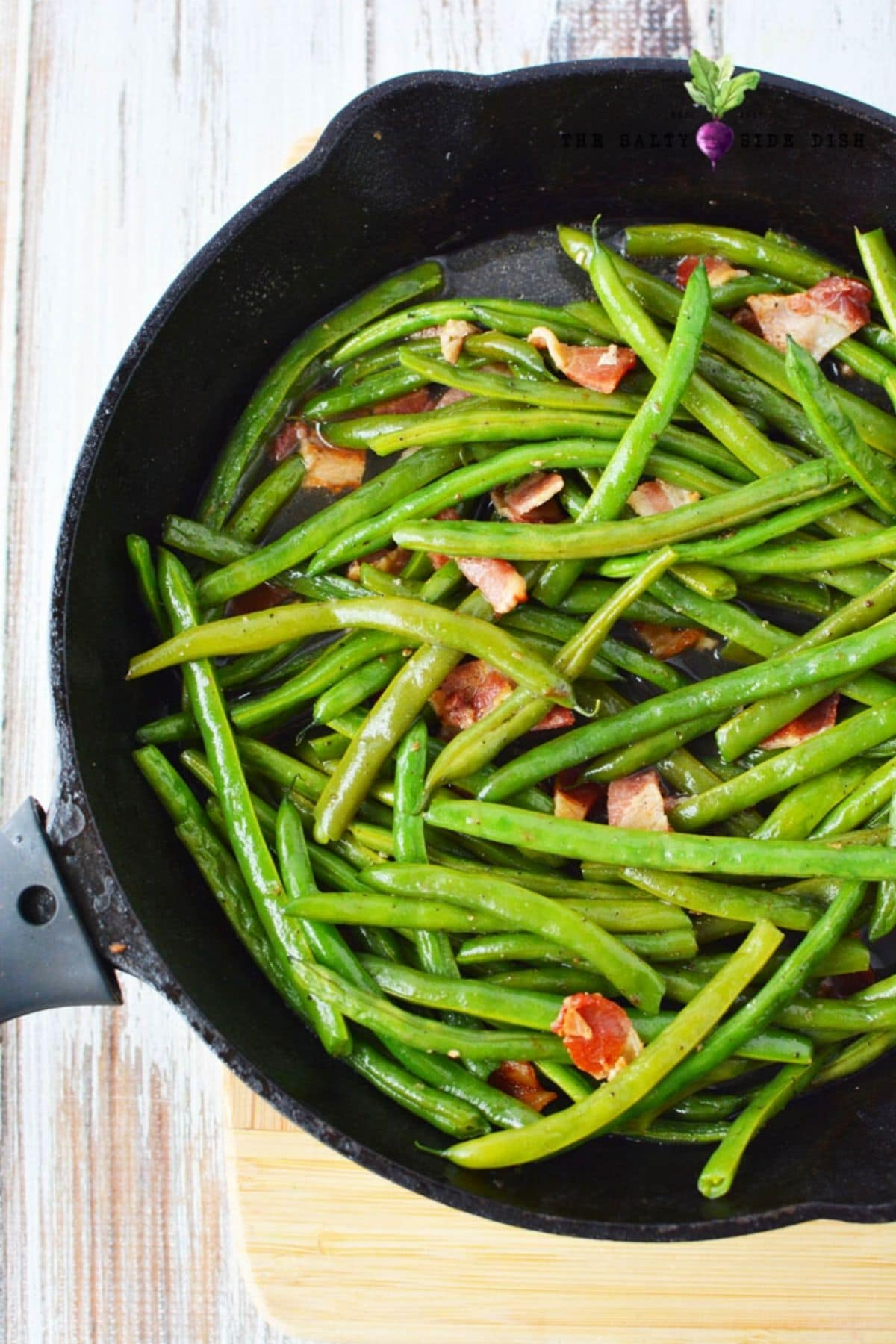 cooking fresh green beans in a cast iron pan