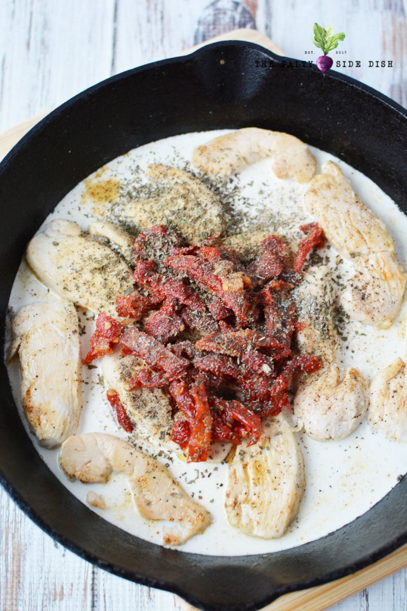 mix your sauce chicken and spices into your cast iron pan