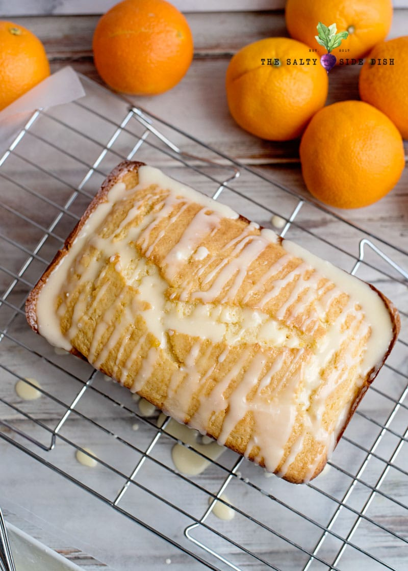 pour orange glaze over cooled orange bread