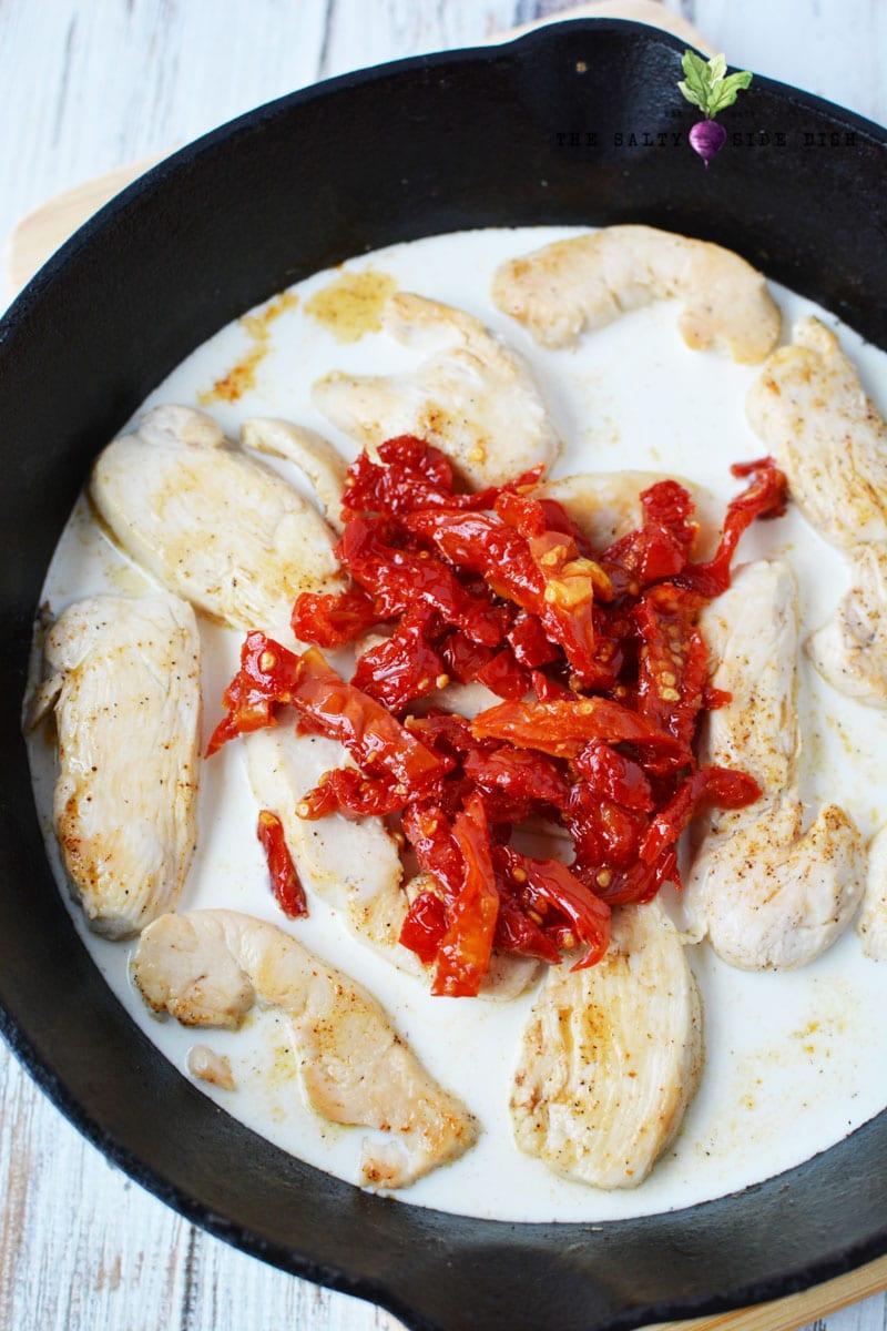 sun dried tomatoes in a pan of creamy cajun chicken recipe