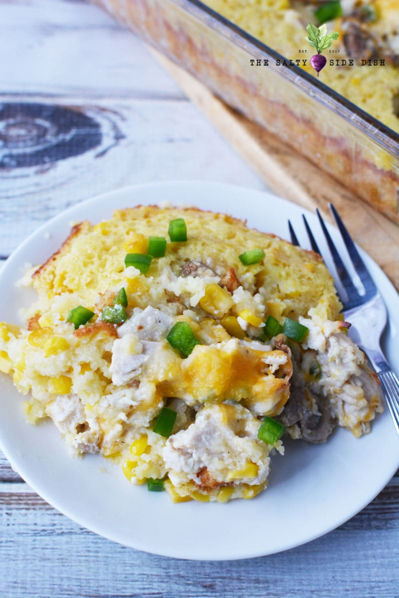 chicken mexican corn bake on a plate with creamy corn and mushrooms