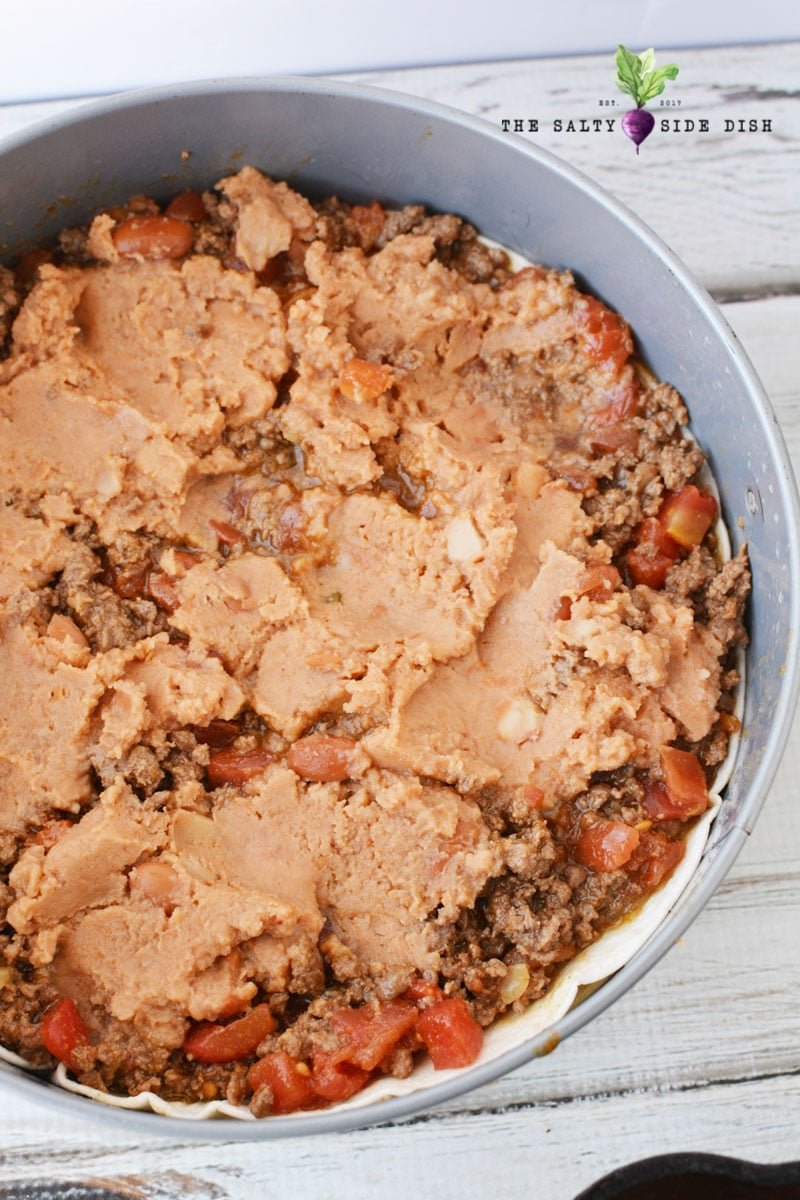 refried beans in your taco pie layers, use a spatula to make the pie