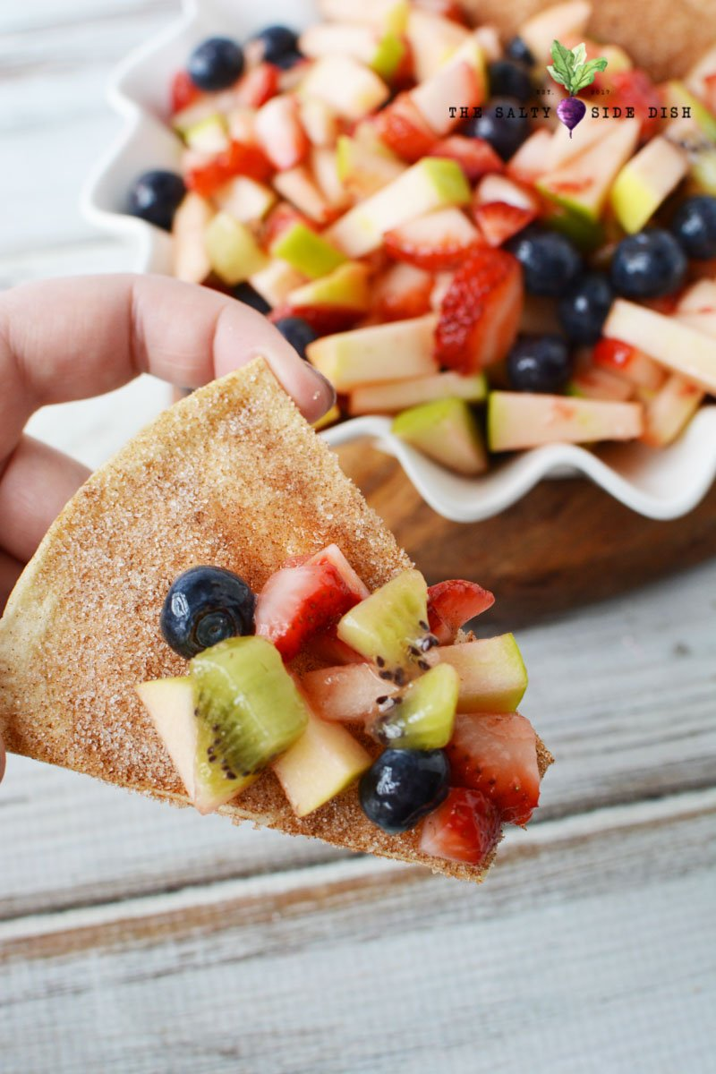 Fruit salsa recipe loaded on a cinnamon chip