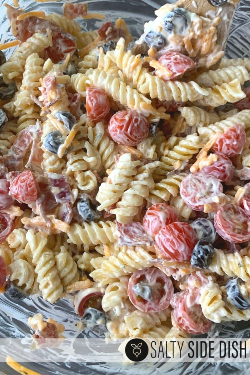 pasta salad side dish with tomatoes and ranch and cheese