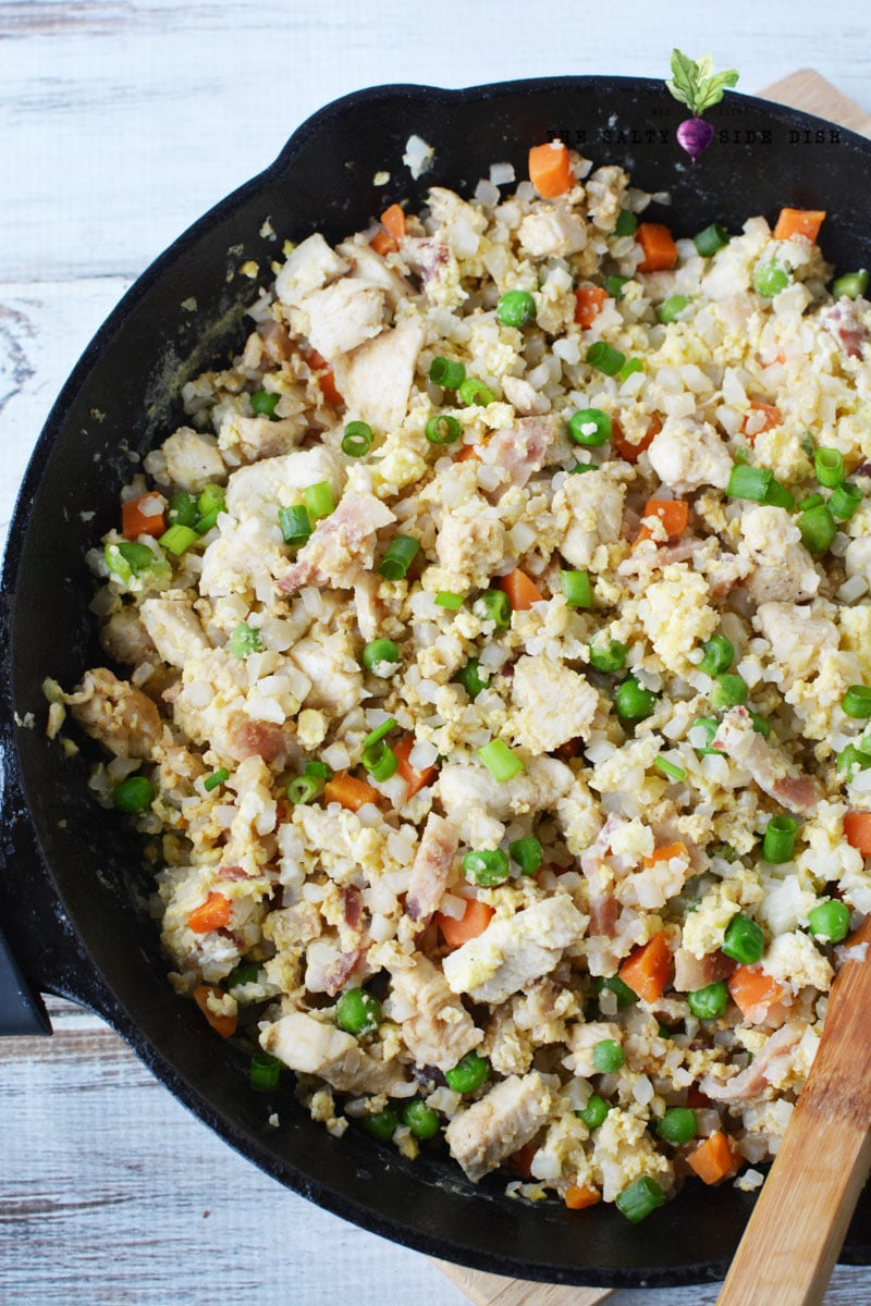 Keto Chicken Fried Rice made with Cauliflower Rice and fresh vegetables in a cast iron pan