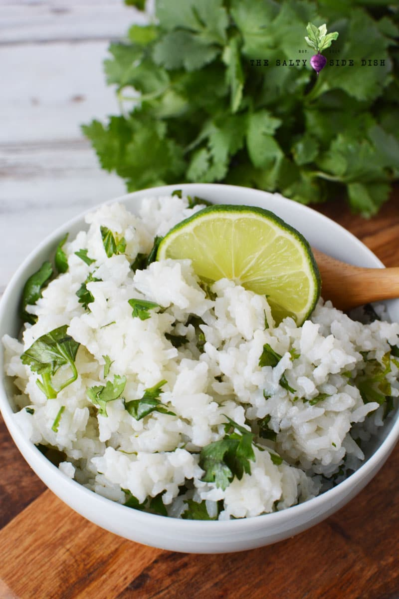 chipotle cilantro lime rice with fresh lime in a bowl
