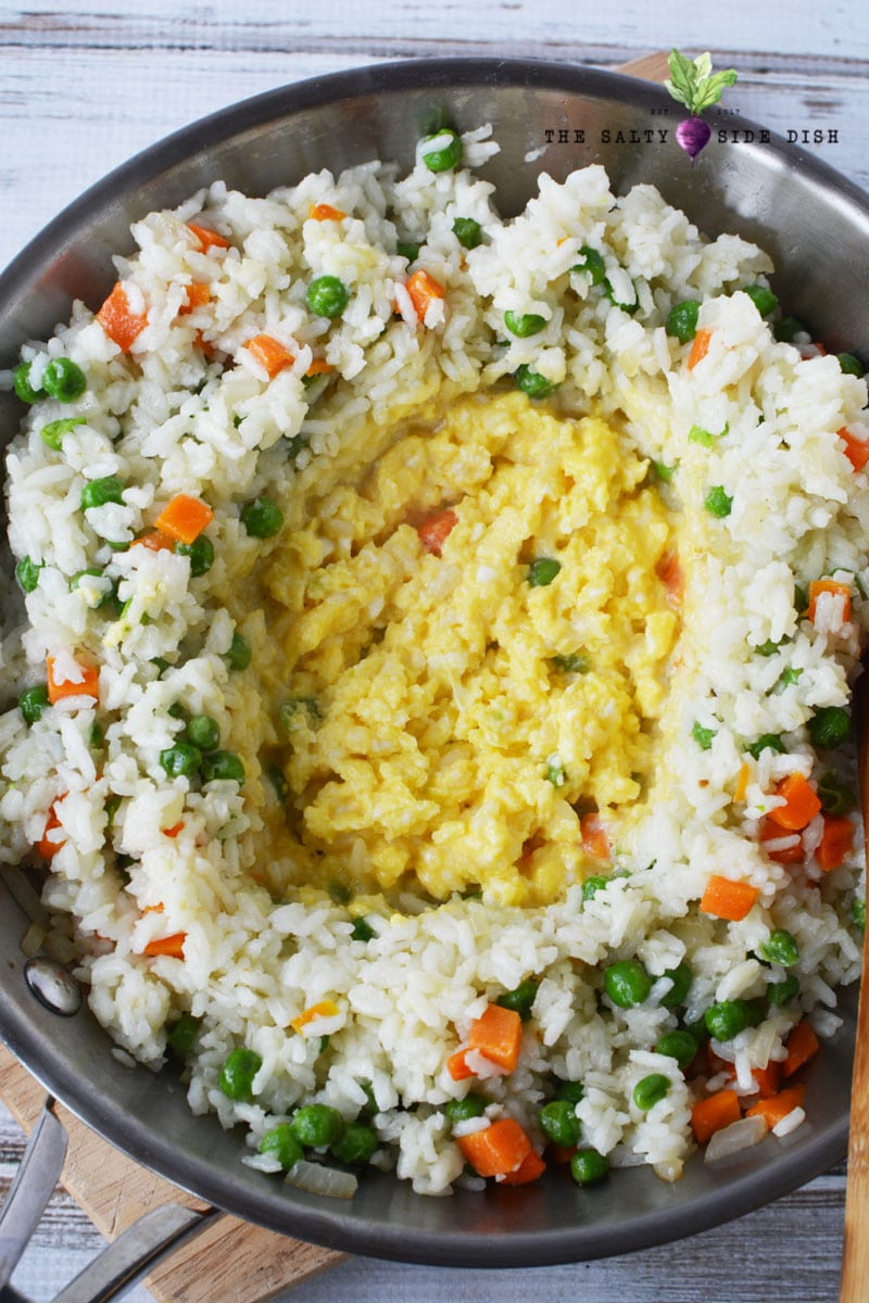 scrambling eggs in the middle of rice