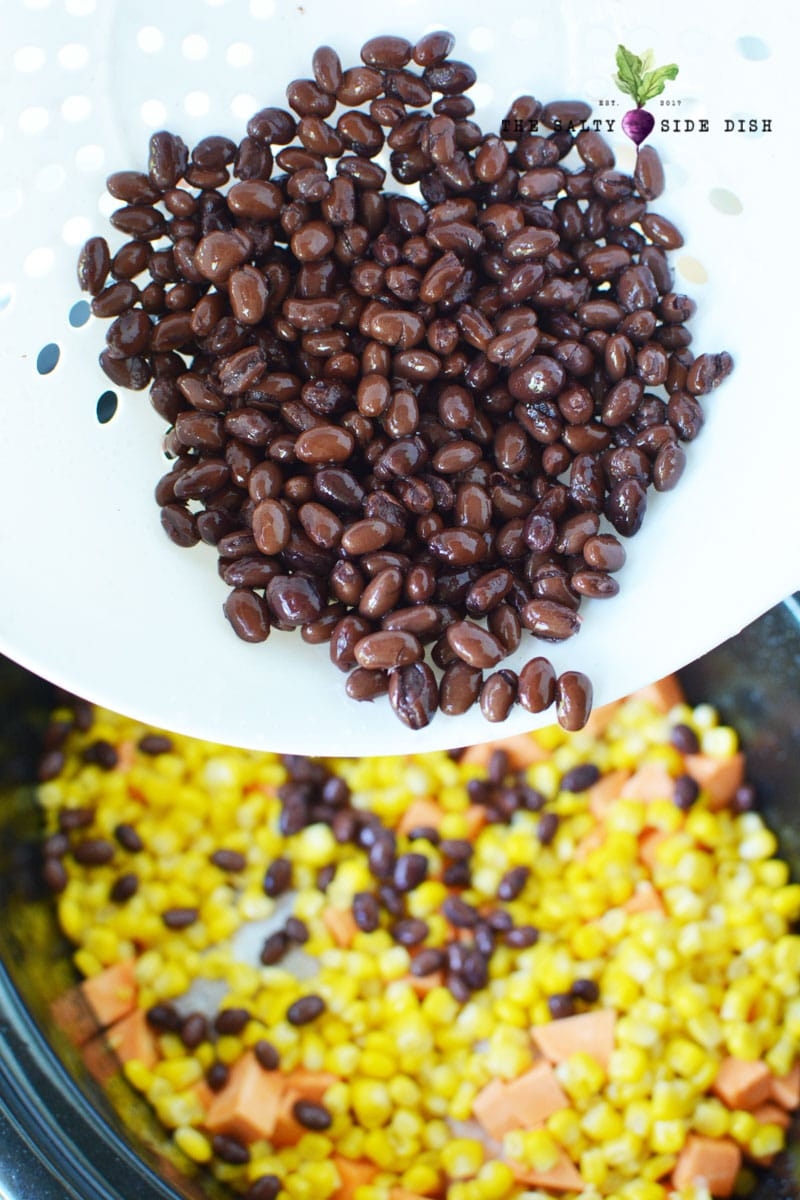 add black beans to corn and sweet potatoes in your crock pot or slow cooker