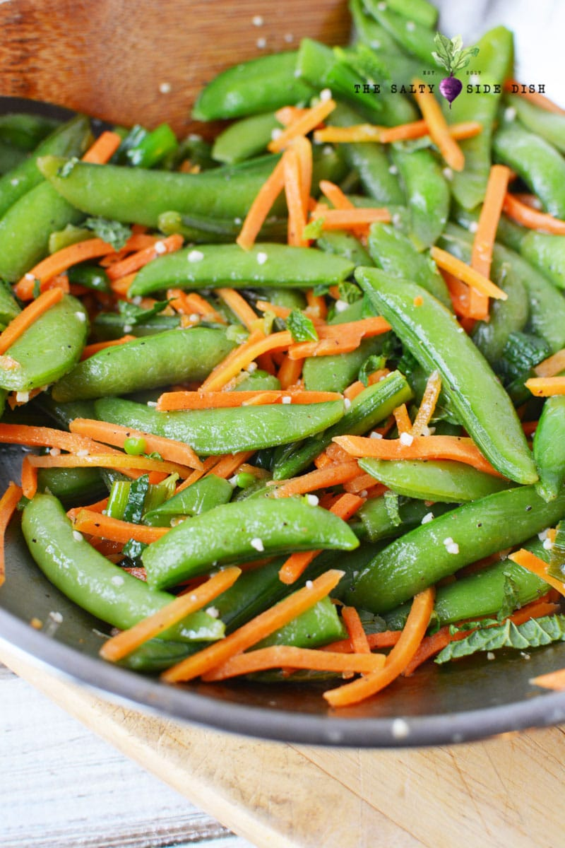 Olive oil skillet sauteed sugar snap peas with garlic and matchstick carrots