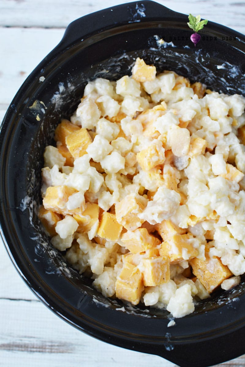 mix together Velveeta, potatoes, butter and spices for an easy slow cooker crockpot side dish