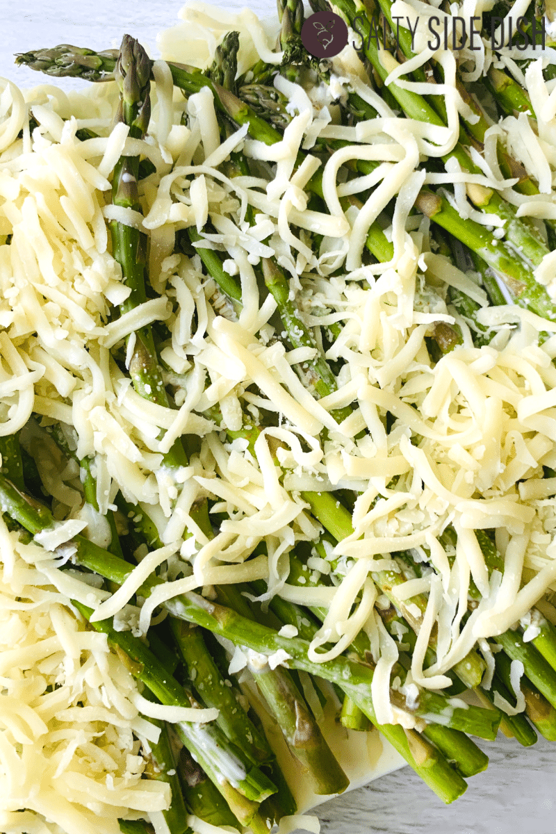 asparagus covered in mozzarella and Parmesan cheese