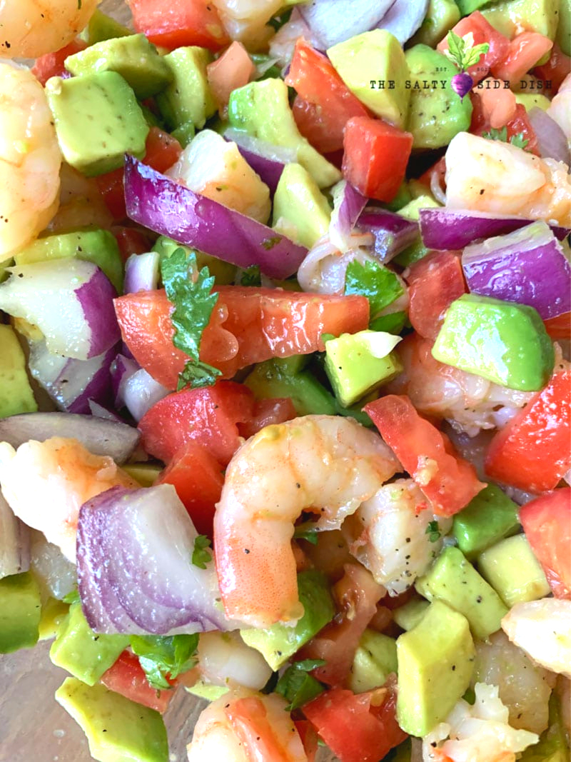 Mediterranean Shrimp Salad toss in a lemon and olive oil on a plate and ready to serve recipe done in 10 minutes