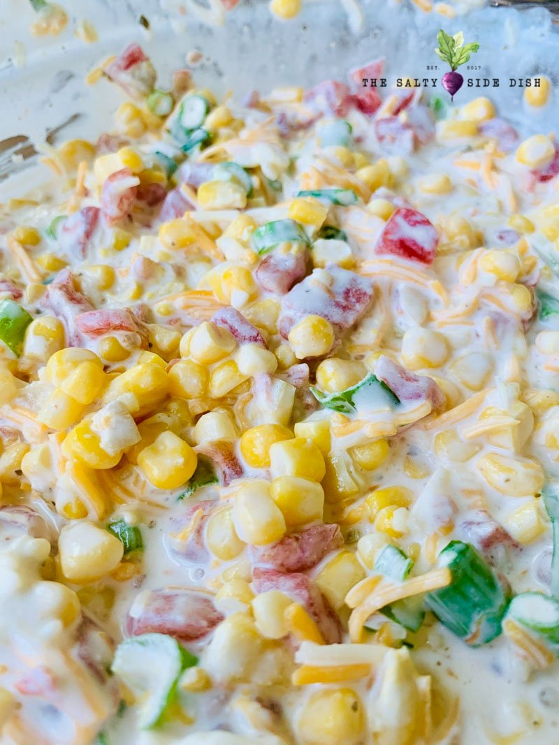 amazing corn dip for a party with fresh kernels of corn in a creamy dipping sauce