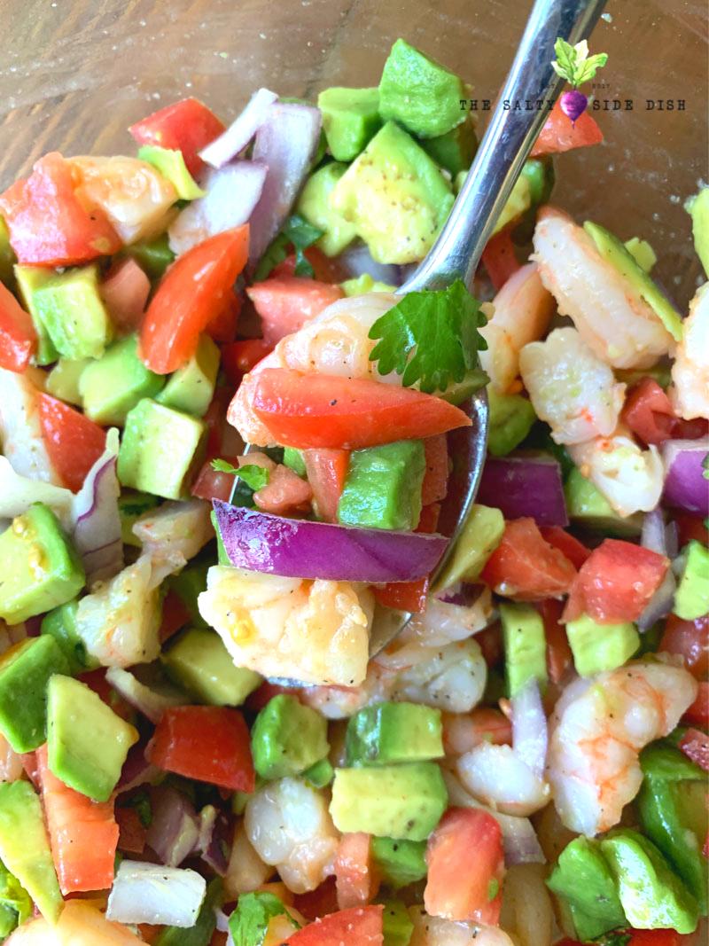 avocado and shrimp salad on a spoon
