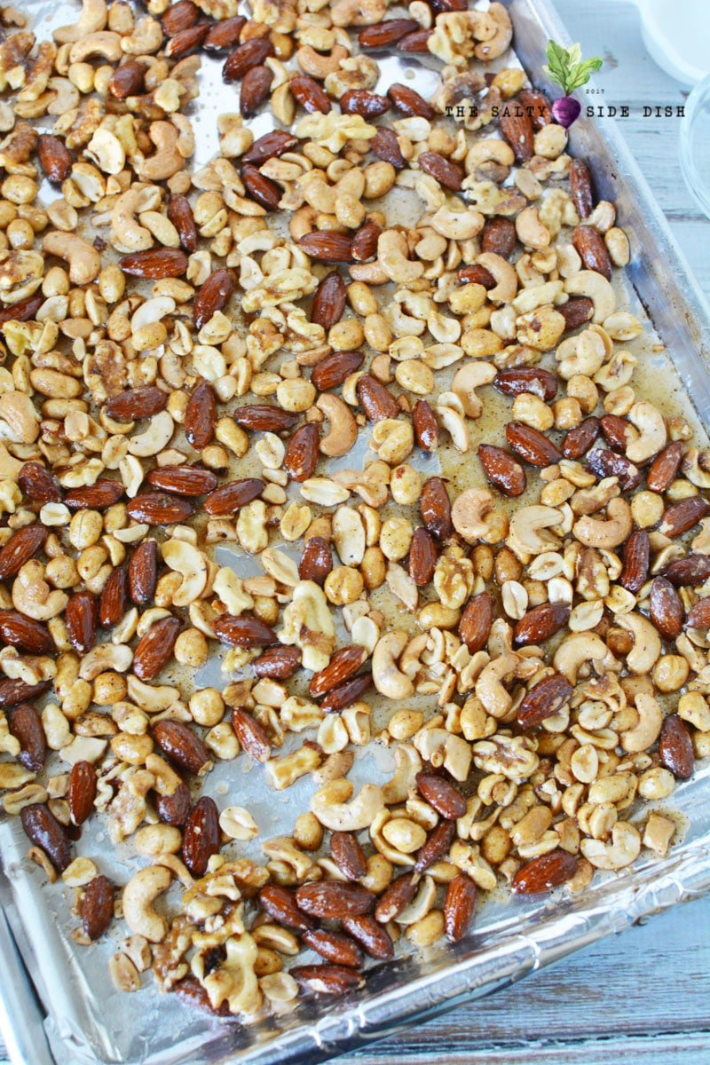 spiced nut mixture laying on a sheet pan