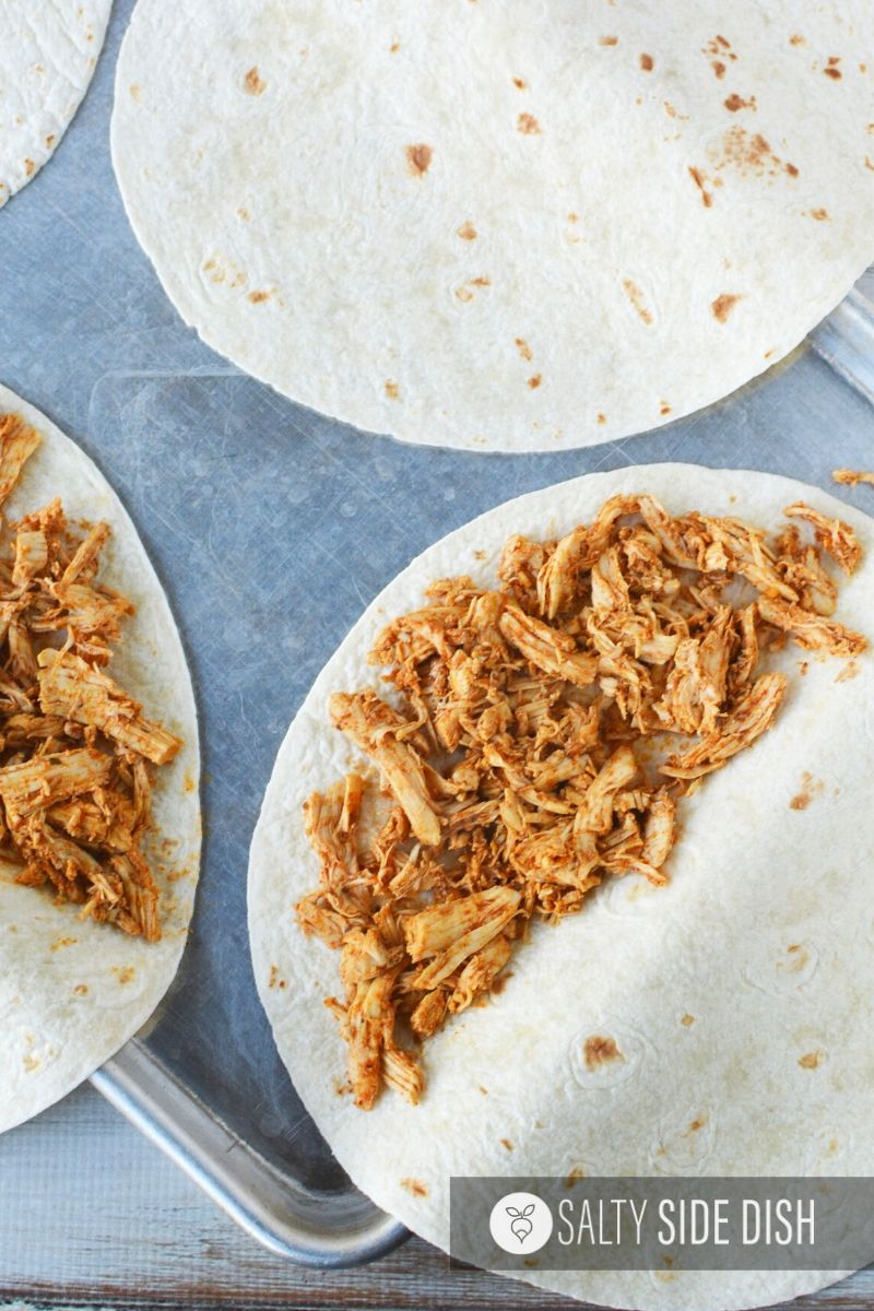 shredded chicken on half of torilla