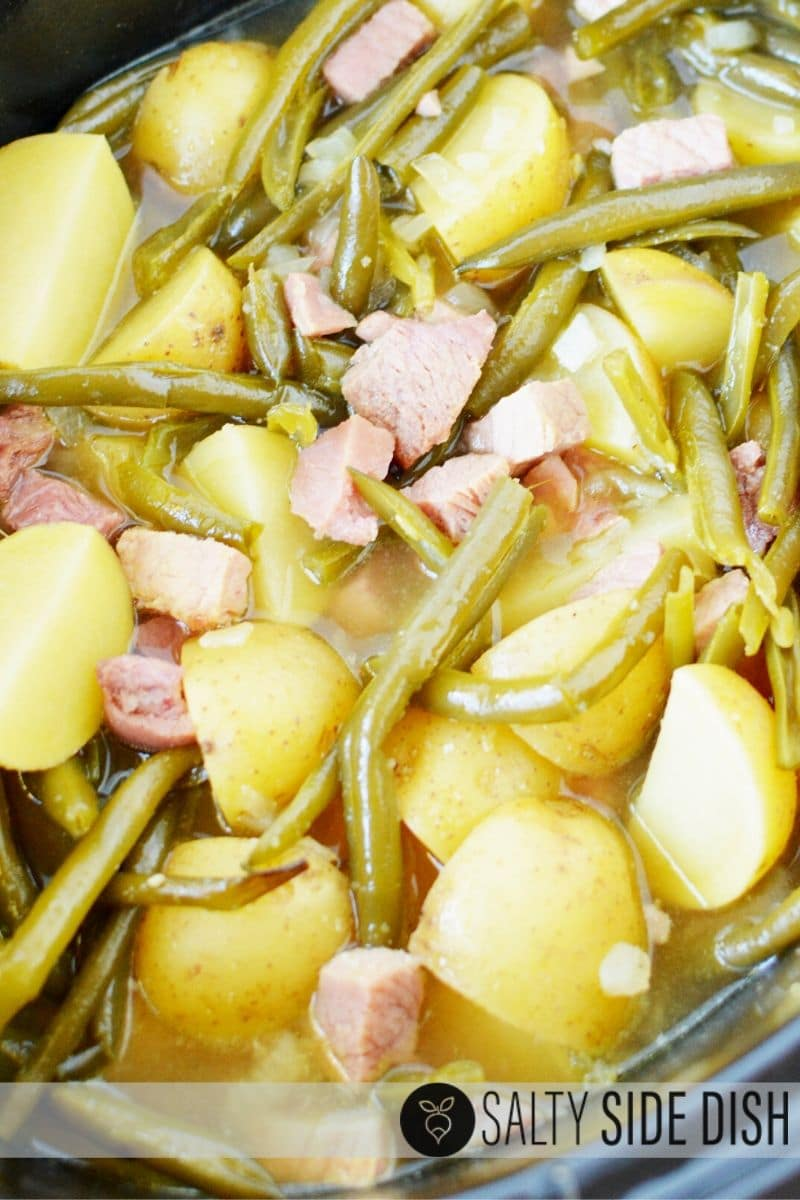 slow cooker green beans, ham, and potatoes in a liquid