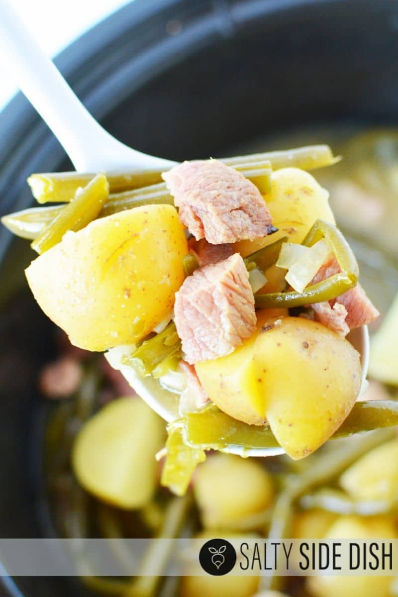 spoon with green beans, ham and potatoes