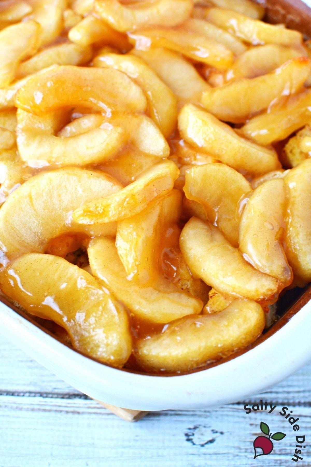 apple pie breakfast bake in a white casserole dish.